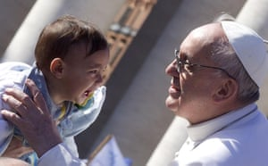 Inaugural Mass: Pope Francis blesses a child as he arrives in St Peter's square