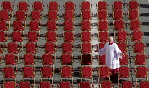 Inaugural Mass: A prelate stands in between rows of seats