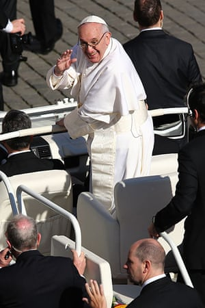Inaugural Mass: Pope Francis waves to the crowd as he arrives in the popemobile