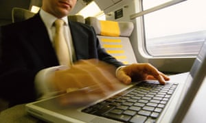 man working on a laptop on a train