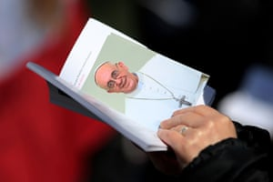 Inaugural Mass: A wellwisher holds an image of Pope Francis