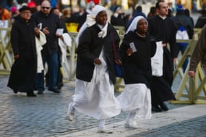 Pilgrims run into the St Peters square to witness the inauguration of Pope Francis.