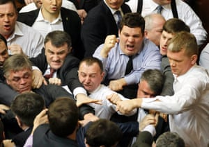 Order! Order! Opposition lawmakers clash with deputies from the pro-presidential majority during a parliament session in Kiev, Ukraine. Photograph: Sergey Dolzhenko/EPA