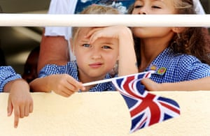 A young girl can scarcely conceal her excitement as she waits to welcome The Prince of Wales and the Duchess of Cornwall during their visit to the British School, on the outskirts of Muscat, on day three of the Royal Tour of Oman.