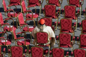 A cardinal sits in St. Peter's Square at the Vatican. Pope Francis urged princes, presidents, sheiks and thousands of ordinary people gathered for his installation Mass on Tuesday to protect the environment, the weakest and the poorest, mapping out a clear focus of his priorities as leader of the world's 1.2 billion Catholics.