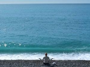 A sun worshipper strikes lucky on the beach in Nice, France today.