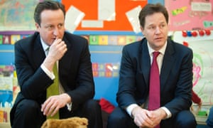 Britain's Prime Minister David Cameron, left, and Deputy Prime Minister Nick Clegg visit the Wandsworth Day Nursery in London.