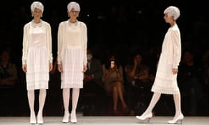 It'll be all white on the night - models display creations by Japanese designer Kunihiko Morinaga during the 2013-2014 Autumn/Wiinter collection at the Tokyo Fashion Week.