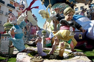 A Falla - or Ninot - a gigantic sculpted satirical structure made of cardboard and other materials, caricaturing German Chancellor Angela Merkel, right, and Spanish Prime Minister Mariano Rajoy, left, during an exhibition for the Fallas Festival, in Valencia, Spain.