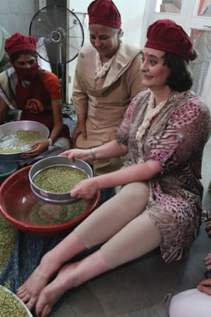 Finger on the pulse - Cherie Blair, right, wife of former British Prime Minister Tony Blair tries her hand at cleaning pulses during her visit to the Rural Distribution Network India (RUDI) centre in Surendranagar district, Gujarat, India.