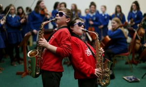 Twelve year olds Dara Maher (left) and Tommy Farrell from St. Canice's National School, perform in Dublin for the Electric Ireland 2013 Feis Ceoil School Orchestra competition.