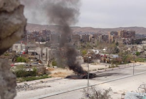A tank belonging to forces loyal to Syria's President Bashar al-Assad is set on fire during what activists said were clashes between government forces and the Free Syrian Army, in the main south highway near Damascus.