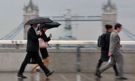 City workers cross London Bridge