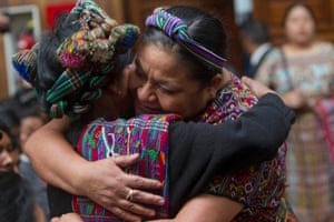 Nobel Peace Prize Laureate winner Rigoberta Menchu, right, hugs the relative of a victim of the country's civil war, as they stand in court during Guatemala's former dictator Jose Efrain Rios Montt's trial on genocide charges in Guatemala City.