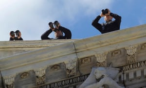 Security personnel atop the U.S. Capitol scan the area with their binoculars before U.S. President Barack Obama and Irish Prime Minister Enda Kenny walk down the east steps after attending the Friends of Ireland luncheon in Washington. Photograph: Gary Cameron/Reuters