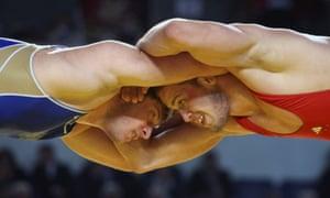 Imants Lagodskis (R) of Latvia in action against Vladislav Baytsaev of Russia during their men's 96kg category bronze medal bout at the European Senior Wrestling Championships in Tbilisi, Georgia.
