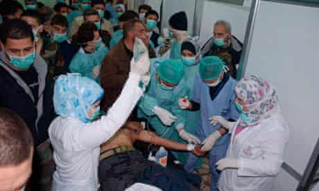 Medics attend to a man at a hospital