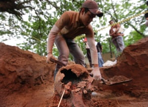 A member of Paraguay's Truth and Justice Commission excavates human remains discovered buried at the National Police Special Forces headquarters in Asuncion, Paraguay. This is the 14th skeleton found since 2009 at the location which was used as a clandestine prison during the military dictatorship of Gen. Alfredo Stroessner. Photograph: Jorge Saenz/AP