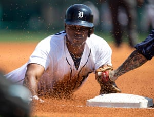 Detroit Tigers' Torii Hunter slides into third base after hitting a triple against the Tampa Bay Rays during the first inning of their MLB spring training baseball game in Lakeland, Florida.