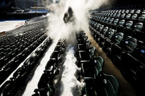 Barry Maddox sprays thick layers of snow and ice off the seats of Target Field in Minneapolis, United States. Crews used high-pressure heated water to clean snow and ice from the seats of the baseball field in preparation for the Minnesota Twins' opening day baseball game against the Detroit Tigers on April 1.