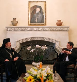 Cypriot president Nicos Anastasiades meets Orthodox Archbishop Chrysostomos about the country's rejection to a proposed levy on bank deposits, at the presidential palace in Nicosia. Photograph:  EPA/Katia Christodoulou