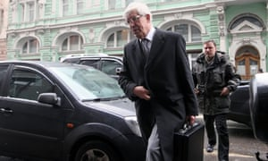 Chairman of the Central Bank of the Russian Federation Sergei Ignatyev (front) arrives for Russian-Cyprus talks at the Russian Finance Ministry in Moscow.  EPA/Sergei Chirikov
