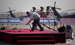 Workers make final preparations before an official welcoming ceremony for US President  Barack Obama on his arrival at Ben Gurion Airport.