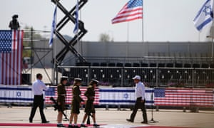 Female Israeli soldiers walk towards their positions as they prepare for an official ceremony to welcome Obama at Ben Gurion International Airport.