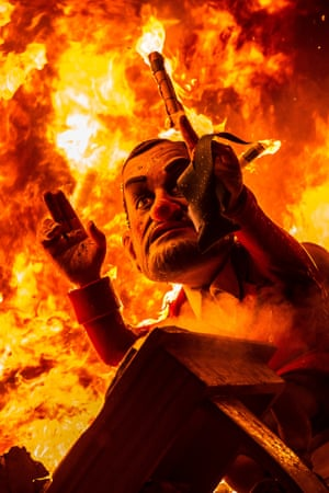 A Ninot depicting Spanish Prime Minister Mariano Rajoy burns during the last day of the Las Fallas Festival  in Valencia, Spain. The Fallas festival celebrates the arrival of spring with fireworks, fiestas and bonfires made by large puppets named Ninots.