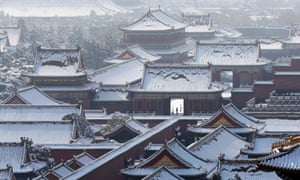 A man walks inside the snow-covered Forbidden City after heavy snowfall overnight, in central Beijing.