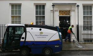 Just making sure there are no banana skins? A cleaner washes the pavement in front of 11 Downing Street in London, before Chancellor George Osborne's Budget later today.