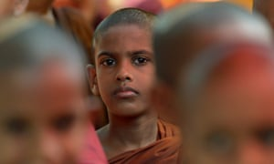 A Sri Lankan Buddhist monk watches outside the Indian High Commission during a protest against attacks on Sri Lankans visiting the south Indian state of Tamil Nadu, in Colombo.