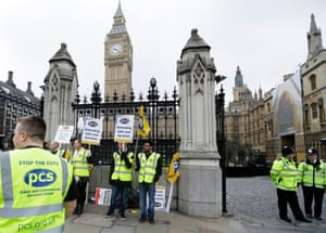 Government employees, who are members of Public and Commercial Services Union, take part in a picket outside the Place of Westminster during a one day strike in London, Wednesday, March, 20, 2013.