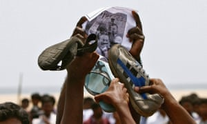 College students hit a portrait of Sri Lanka's President Mahinda Rajapaksa during a protest at Marina beach in the southern Indian city of Chennai. The students allege that Sri Lanka is responsible for  the deaths of thousands of civilians during the final months of a three-decade war with ethnic Tamil rebels in 2009.