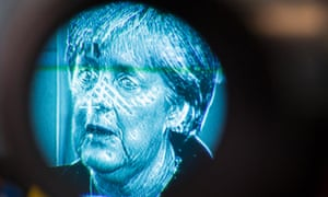 A particularly scary photo of German Chancellor Angela Merkel as she speaks to the media about the situation in Cyprus.