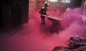 An Indian labourer sifts coloured powder, known as 'gulal', to be used during the forthcoming spring festival of Holi, on the outskirts of Siliguri.