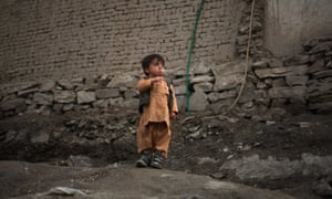 An Afghan child outside his home in Kabul with what I hope is a pea-shooter or a lollipop.