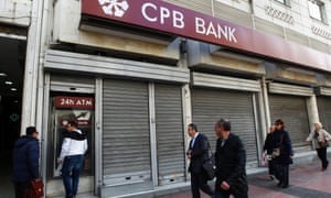 A closed Cyprus Popular Bank branch in Athens yesterday. Photograph: EPA/Orestis Panagiotou