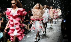 Models on the DressCamp catwalk wearing designs by Toshikazu Iwaya during the Mercedes-Benz Fashion Week in Tokyo, Japan.