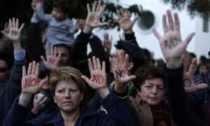 "Cypriots show their palms reading ""No"" d"