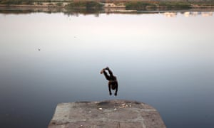 People diving into rivers is something we see a lot of but this one looks a little more risky than most: A man jumps in to the river Yamuna in New Delhi, India. Officials say factories are ignoring regulations and dumping untreated sewage and industrial pollution, turning the river that gives the capital much of its drinking water toxic.