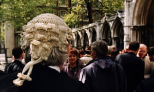 Barrister in a wig outside high court in London
