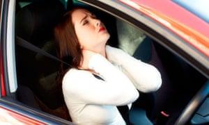 Girl massaging neck in a car
