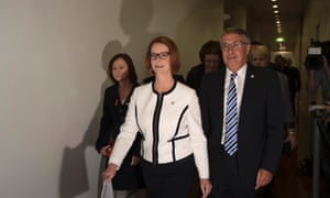 Prime minister Julia Gillard and her supporters arrive for the meeting of the Labor Caucus