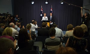 Prime minister Julia Gillard and Treasurer Wayne Swan make a statement after the meeting of the Labor Caucus