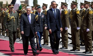 President Barack Obama, right, and Palestinian President Mahmoud Abbas, front left, walk along to red carpet for a troop review during an arrival ceremony as Obama arrives at the Muqata Presidential Compound.