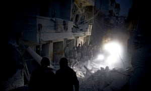 Poeple search for survivors under the rubble after an airstrike by government forces in the neighborhood of Al Sukary in Aleppo last night.