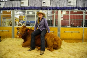 A woman chooses an unusual spot for a rest on the first day of the Royal Easter Show in Sydney, Australia.