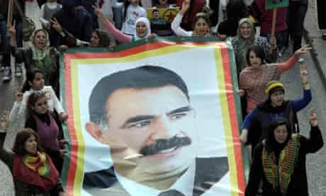 Kurdish supporters of the Kurdistan Workers party (PKK) carrying a posters of Abdullah Öcalan