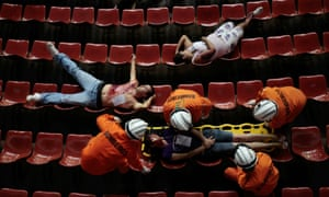 Brazilian paramedics and firefighters train during a simulated emergency situation